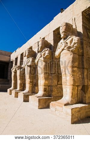 Luxor, Egypt - Jan 28, 2020: Mighty stone pillars of Luxor Temple in Luxor, ancient Thebes, Egypt. Luxor Temple is a large Ancient Egyptian temple complex located on the east bank of the Nile River