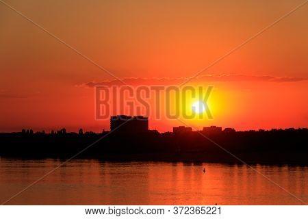 Orange Sunset Over A River Dnieper In Kremenchug City, Ukraine