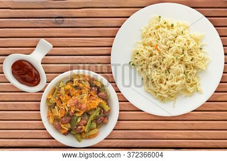 Vermicelli On A White Plate On Orange Wooden Background. Vermicelli On A Plate With Vegetarion Salad