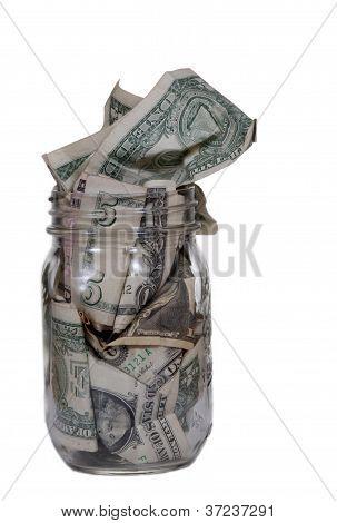 Glass Jar Full Of Dollar Bills.