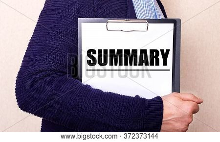 The Word Summary Is Written On A White Tablet Held By A Man.