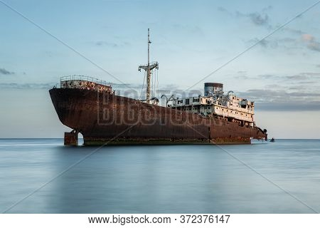 Shipwreck At The Sunset On A Lanzarote Coast With Copy Space