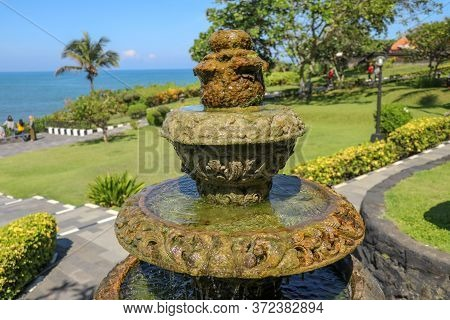 Peaceful Scenery With Fountain. Park Near The Hindu Temple Tanah Lot, Bali, Indonesia. Small Decorat
