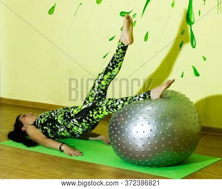Woman Doing Fitness Exercise, Young Woman Doing Fitness Exercises With Fitness Ball In Fitness Club