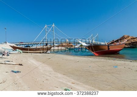 Traditional Dhow Boat Yards In Sur, Oman. Khor Al Batar Bridge In The Background.