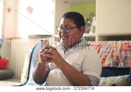 portrait of child with smartphone at home
