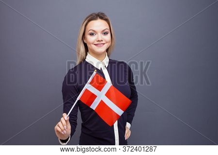 Immigration And The Study Of Foreign Languages, Concept. A Young Smiling Woman With A Denmark Flag I