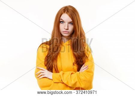 Shocked Perplexed Young Redhead Woman Girl In Casual Yellow Hoodie Posing Isolated On White Backgrou