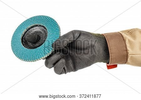Worker Hand In Black Protective Glove And Brown Uniform Holding Blue Abrasive Flap Disc For Grinding