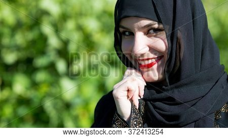Eastern Woman In National Dress With Red Lips Painted On Street Smiling. Beautiful Young Muslim Woma