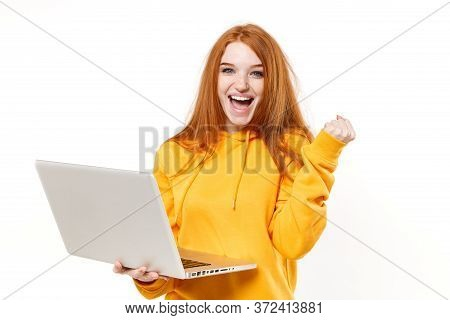 Joyful Young Redhead Woman Girl In Yellow Hoodie Posing Isolated On White Wall Background Studio Por
