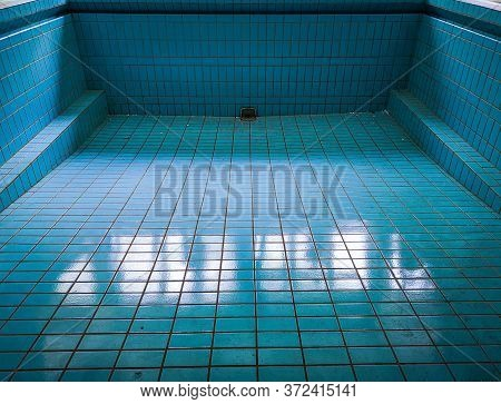 Empty Blue Swimming Pool In Old Abandoned Hospital