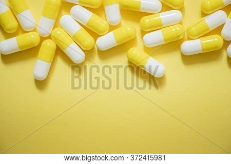 Pills With Medicine On Yellow Background Close, Painkillers And Antiviral Drugs, Antibiotics In Caps