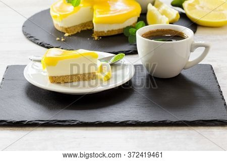 Creamy Cheesecake, Delicious Lemon Cheesecake And Cup Of Coffee Closeup