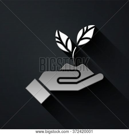 Silver Plant In Hand Of Environmental Protection Icon Isolated On Black Background. Seed And Seedlin