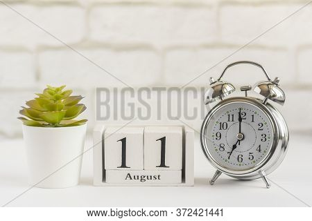 August 11 On A Wooden Calendar Next To The Alarm Clock. Summer Day, Empty Space For Text.calendar Fo