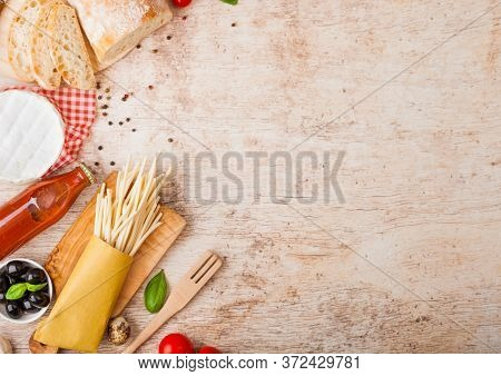 Homemade Spaghetti Pasta With Quail Eggs With Bottle Of Tomato Sauce And Cheese On Wood Background.