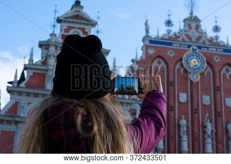 Riga, Latvia - September, 2019: Girl Is Making Photo Of The Riga House Of The Blackheads Building In