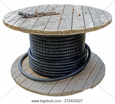 Black Wire Electric Cable With Wooden Coil Of Electric Cable On White Background