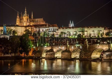 Nightscape Of The Prague Skyline Over The River Vltava