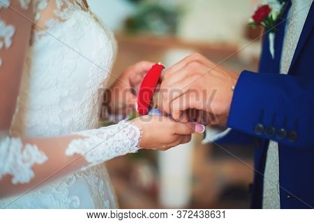 Brides Holding A Box With A Heart And Beads