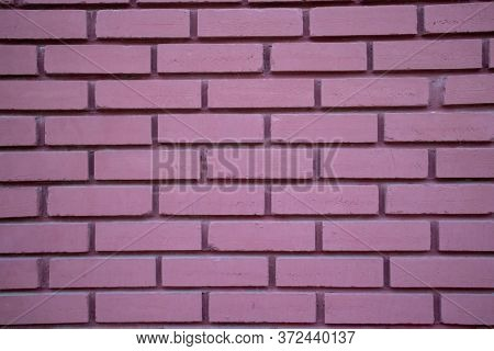 Vintage purple color brick wall background and texture, building facade wall grunge material