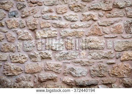 Vintage white beige color stone wall background and texture, building facade wall grunge material