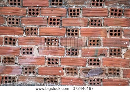 Vintage red brown color brick wall background and texture, building facade wall grunge material
