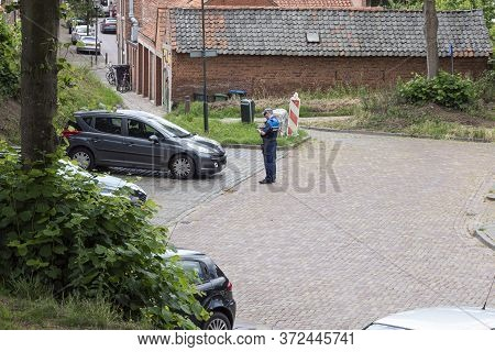 Hulst, The Netherlands June 20, 2020, Profile Of An Enforcer Writing A Ticket