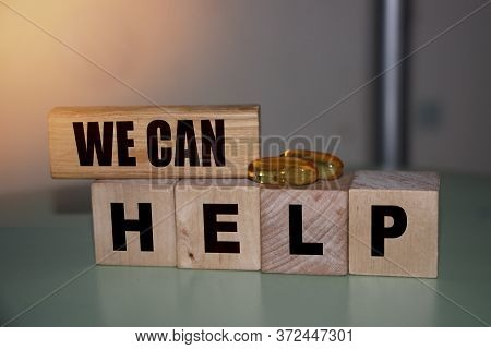 We Can Help - Phrase On Wooden Blocks With Letters, Mutual Assistance Companionship Concept