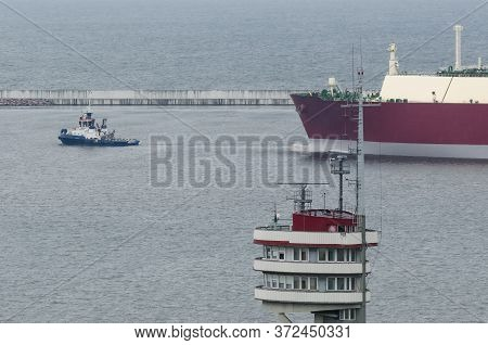 Lng Tanker In The Seaport - The Ship Maneuvers In The Gas Terminal Basin