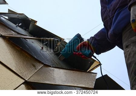 Assembling The Gilded Dome Of An Orthodox Church. The Worker Dries The Place Of Gluing The Elements