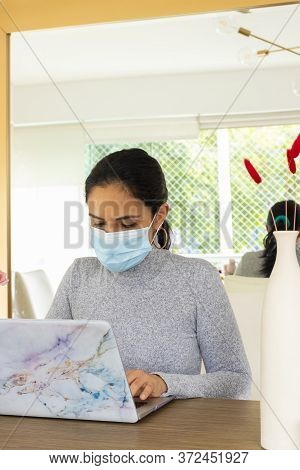 Beautiful Latin Woman Conducting Home Office For The Corona Virus Pandemic