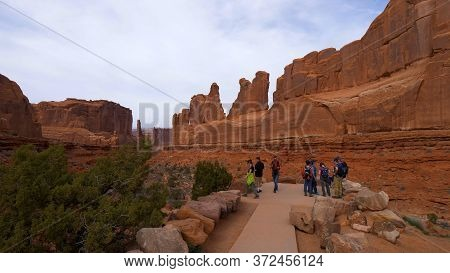 Tourists Visit The Arches National Park In Utah- Utah, United States - March 20, 2019