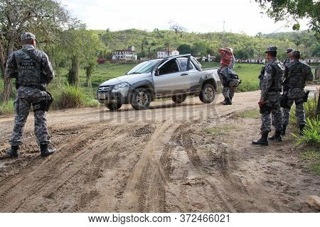Pau Brasil, Bahia / Brazil - May 10, 2012: National Force Military Personnel Approach Vehicles And P