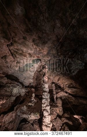 Inside The Mysterious Flowstone Cave 'nebelhöhle' With Stalagmites And Stalactites In Germany.