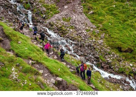 Ben Nevis / Uk - August 24 2019: Hikers On 'mountain Path', The Most Popular Route Up Ben Nevis, In