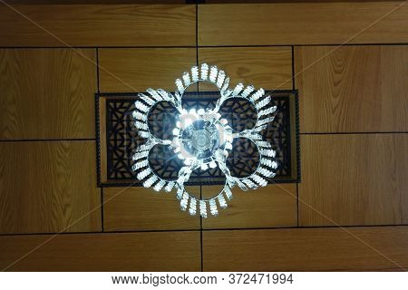 A Beautiful Cristal Light Decor On A Wooden Ceiling