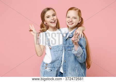 Cheerful Little Kids Girls 12-13 Years Old In White T-shirt, Denim Clothes Isolated On Pink Backgrou
