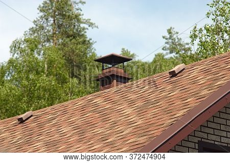 Chimney On The Roof Of A Brick House