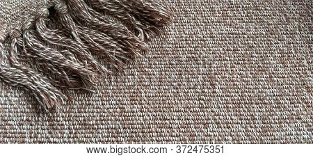 Woven Fabric With Tassels. Coarse Weaving Cotton. Floor Mat. Beige, White And Wrinkled Threads In We