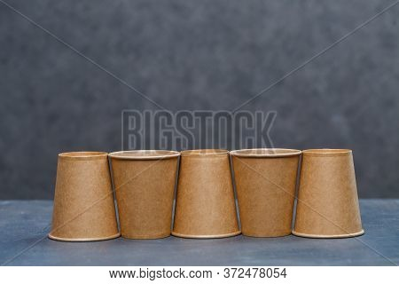 Paper Cups For Drinking, Dishes. Disposable Cardboard Dishes Made From Environmentally Friendly Mate