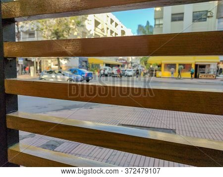 A Wood Window Overlooking The Street. High Quality Photo