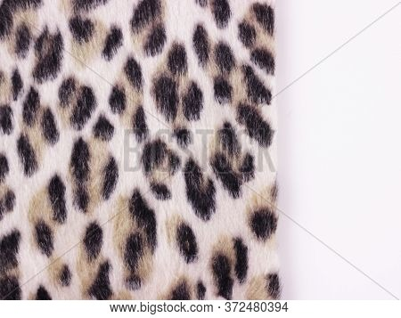Beautiful Leopard Faux Fur On White. Texture Or Background Concept. Close Up. Copy Space