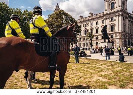 London / Uk - 06/20/2020: Metropolitan Police Officers On Horses Protecting Sir Winston Churchill St
