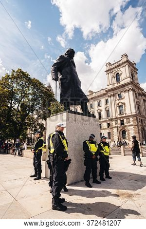London / Uk - 06/20/2020: Metropolitan Police Officers Protecting Sir Winston Churchill Statue From