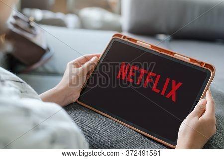 Woman Watching Netflix On Ipad , Netflix App On Tablet Screen. Netflix Is An International Leading S