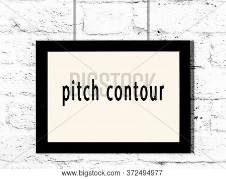 Black Wooden Frame With Inscription Pitch Contour Hanging On White Brick Wall
