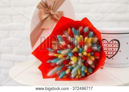 Dried Flowers Bouquet On The Table. Decorative Flowers Decoration. A Bouquet Of Dried Flowers And El