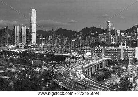 Skyline And Highway Of Hong Kong City At Dusk
